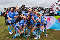 The Blue team including George Harrison (front centre) (TOWIE), Fran Parman (front left) (TOWIE), Nancy May Turner (front right) (Ex on the Beach) celebrate there 3rd place medals during the SOCCER SIX Celebrity Football Event at the Queen Elizabeth Olympic Park, London, England on 26 March 2016. Photo by Andy Rowland.