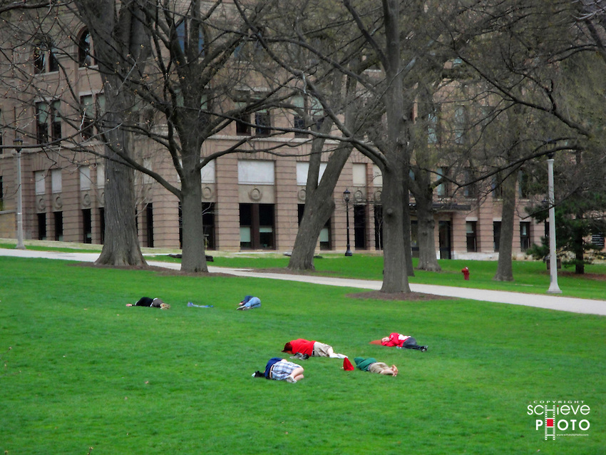 Students take a nap on Bascom Hill on the University of Wisconsin-Madison campus.