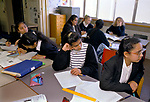 Secondary School 1990s UK. Mixed race group ethnic diversity girl students classroom Greenford High School, Middlesex  London 1990 England <br /> <br /> 4TH FORM GIRL PUPILS DURING GEOGRAPHY LESSON,