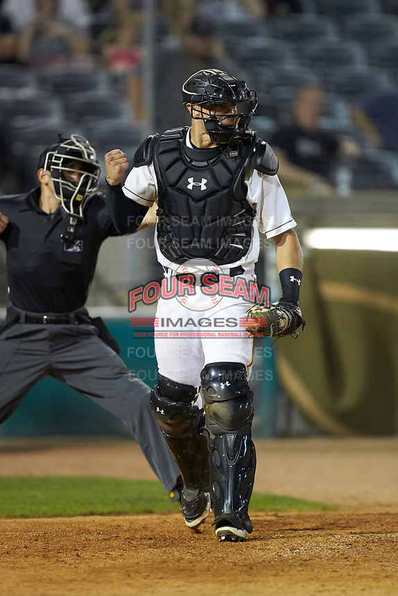 West Virginia Power catcher Deon Stafford (22) pumps his fist after the third out of an inning against the Lexington Legends at Appalachian Power Park on June 7, 2018 in Charleston, West Virginia. The Power defeated the Legends 5-1. (Brian Westerholt/Four Seam Images)