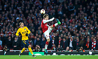 Nacho Monreal of Arsenal clears from Antoine Griezmann of Atletico Madrid during the UEFA Europa League Semi Final 1st leg match between Arsenal and Atletico Madrid at the Emirates Stadium, London, England on 26 April 2018. Photo by Andy Aleksiejczuk / PRiME Media Images