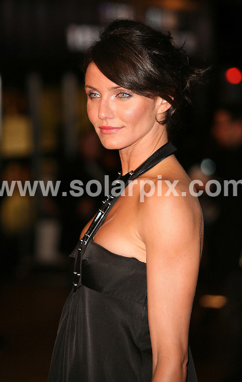 ** ALL ROUND PICTURES FROM SOLARPIX.COM**.Cameron Diaz attends the UK film premiere for the movie The Holiday at the Odeon cinema in Leicester Square , London 05.12.06. JOB REF: 3143/SSD..**MUST CREDIT SOLARPIX.COM OR DOUBLE FEE WILL BE CHARGED**