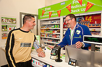 Footballers from The White Swan FC popped into the Pharmacy at ASDA Newark to try out their new free blood pressure testing service. Pictured is Ashley Dearlove with dispensing assistant Sam Maxwell