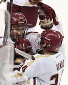 Kevin Hayes (BC - 12), Johnny Gaudreau (BC - 13), Bill Arnold (BC - 24) - The Boston College Eagles defeated the visiting Boston University Terriers 6-4 (EN) on Friday, January 17, 2014, at Kelley Rink in Conte Forum in Chestnut Hill, Massachusetts.