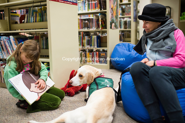 WOODBURY, CT- 5 January 2015-010516EC01-   Alisa Samodelko, 6, reads a book to Maggie, a pet therapy dog at the Woodbury Public Library Tuesday night. Terri-Gayle Mazur brings Maggie to the library every month for children to read to her. They will visit again February 2nd at 5pm. Erin Covey Republican-American