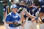 Players greet each other before a Little League game.