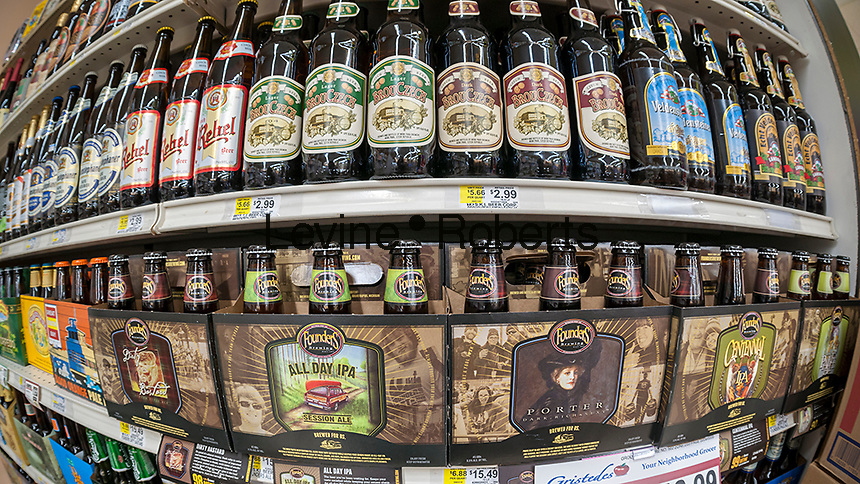 A display of craft and other beers in a supermarket in New York on Thursday, June 30, 2016. (© Richard B. Levine)