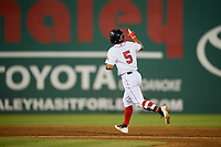 Salem Red Sox shortstop Santiago Espinal (5) gestures as he rounds the bases after hitting a fifth inning home run a game against the Lynchburg Hillcats on May 10, 2018 at Haley Toyota Field in Salem, Virginia.  Lynchburg defeated Salem 11-5.  (Mike Janes/Four Seam Images)