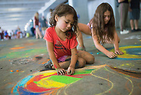 NWA Democrat-Gazette/CHARLIE KAIJO Mersadys Barnes, 4 and Alexys Holt, 8, of Bella Vista (from left) during the first annual chalk festival, Sunday, August 10, 2019 at Crystal Bridges in Bentonville.<br /> <br /> 23 professional chalk artists turned concrete into masterpieces at Crystal Bridges. The artists finished their pieces on Sunday with some 4,000 visitors attending the two-day event. Attendees also enjoyed live music, food trucks and a kids chalking area.