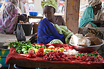 A woman sells vegetables in the marketplace in Segou, Mali.