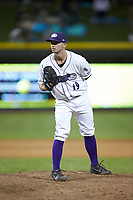 Winston-Salem Dash relief pitcher Ian Clarkin (19) looks to his catcher for the sign against the Frederick Keys at BB&T Ballpark on July 26, 2018 in Winston-Salem, North Carolina. The Keys defeated the Dash 6-1. (Brian Westerholt/Four Seam Images)