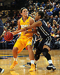 BROOKINGS, SD - DECEMBER 11:  Kerri Young #10 from South Dakota State University has the ball knocked from her hand by Keke Sevillian #10 from Penn State in the first half of their game Wednesday night at Frost Arena in Brookings. (Photo by Dave Eggen/Inertia)