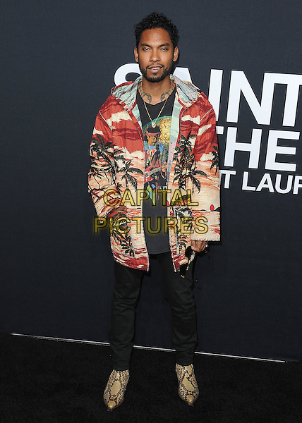 HOLLYWOOD, CA - FEBRUARY 10:  Miguel at Saint Laurent at The Palladium at the Hollywood Palladium on February 10, 2016 in Hollywood, California. <br /> CAP/MPI/PGSK<br /> &copy;PGSK/MPI/Capital Pictures