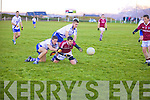 Na Piarsaigh's Kevin O'Shea does enough to get the ball back to his keeper Brian O'Leary and out of reach of the attacking St Mary's men Conor Quirke & Daniel Daly.