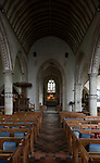 View down the nave to chancel, altar and east window inside the church at church of Saint Mary, Purton, Wiltshire, England, UK
