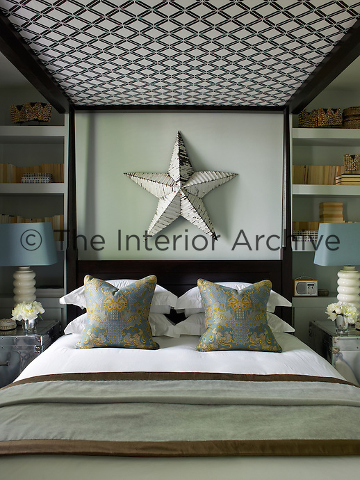 Tones of grey and turquoise offset by crisp white bed linen have created a tranquil feel in the master bedroom