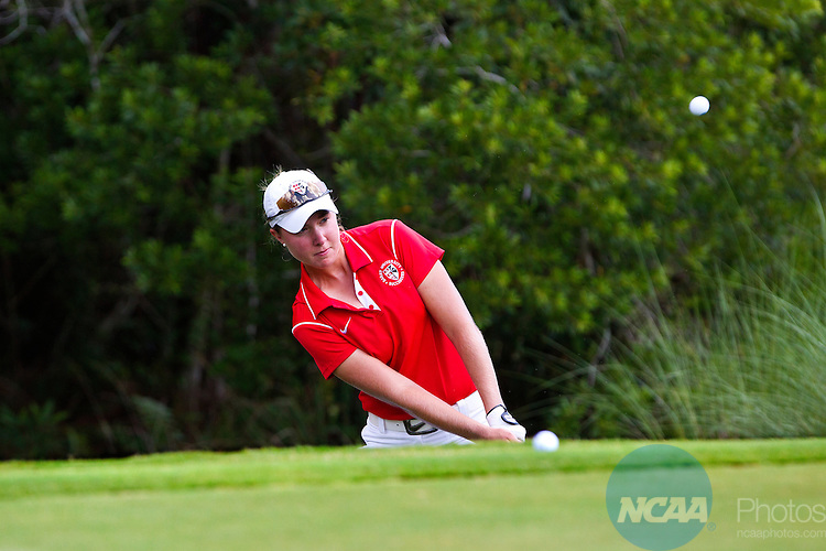 18 MAY 2013:  Daniela Murray of Barry University chips during the Division II Women's Golf Championship held at the LPGA International Golf Course in Daytona Beach, FL.  Lynn University shot a +17 to win the national title by 3 strokes.  Matt Marriott/NCAA Photos
