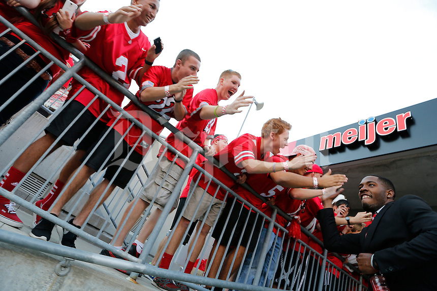 Ohio State Buckeyes quarterback Kenny Guiton (13) high fives fans as the team makes their way into the stadium before the NCAA football game between the Ohio State Buckeyes and the Wisconsin Badgers at Ohio Stadium in Columbus, Saturday evening, September 28, 2013. (Columbus Dispatch  / Eamon Queeney)