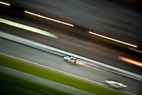Scott Speed scrapes along the wall at the start/finish line leaving a trail of sparks in his wake..4 July, 2009, Daytona Beach, Florida USA..©2009 F.Peirce Williams, USA.
