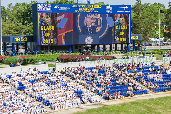 Midshipmen watch as Joe Biden speaks on the scoreboard screen at the 2015 US Naval Academy Graduation and Commissioning Ceremony at Navy-Marine Corps Memorial Stadium on May 22, 2015 in Annapolis, MD.