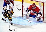 14 December 2009: Montreal Canadiens' goaltender Jaroslav Halak makes a third period save on Patrick Kaleta of the Buffalo Sabres at the Bell Centre in Montreal, Quebec, Canada. The Sabres defeated the Canadiens 4-3. Mandatory Credit: Ed Wolfstein Photo