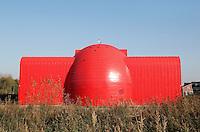 Almere Poort- Warmteoverdrachtstation (WOS) . Het door Schutter-ETH Architectenbureau ontworpen gebouw gaat alle 11.000 woningen en bedrijven in de wijk voorzien van stadswarmte. Het WOS komt  in de als duurzaam aangemerkte wijk Columbuskwartier