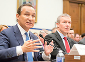 Oscar Munoz, Chief Executive Officer, United Airlines, gives testimony before the United States House Committee on Transportation and Infrastructure hearing concerning airline customer service issues in Washington, DC on Tuesday, May 2, 2017.  Scott Kirby President, United Airlines looks on from right.<br /> Credit: Ron Sachs / CNP