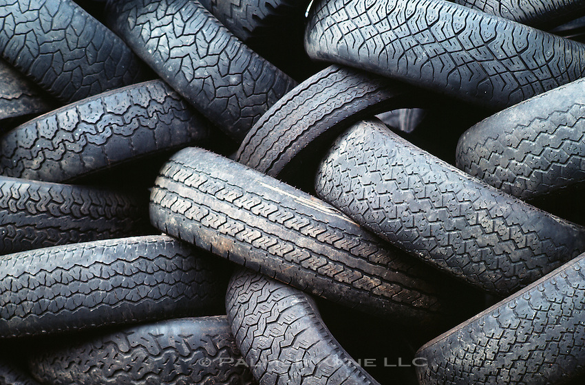Old used tires dumped as garbage in solid waste landfill