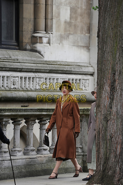*Exclusive All rounder*.Extras filming 'Downton Abbey' at Lincolns Inn in London, England, UK, .30th June 2012..filmset film set full length period drama costumes actors background artists brown coat hat .CAP/IA.©Ian Allis/Capital Pictures.