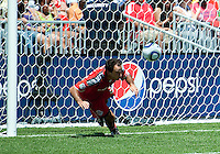 10 July 2010: Toronto FC midfielder Nick LaBrocca #21 clears a ball from in front of the net during a game between the Colorado Rapids and Toronto FC at BMO Field in Toronto..Toronto FC won 1-0.