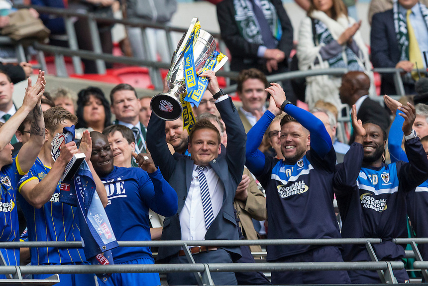 AFC Wimbledon manager Neal Ardley lifts the winner's trophy<br /> <br /> Photographer Craig Mercer/CameraSport<br /> <br /> Football - The Football League Sky Bet League Two Play-Off Final - AFC Wimbledon v Plymouth Argyle - Monday 30 May 2016 - Wembley Stadium - London<br /> <br /> World Copyright &copy; 2016 CameraSport. All rights reserved. 43 Linden Ave. Countesthorpe. Leicester. England. LE8 5PG - Tel: +44 (0) 116 277 4147 - admin@camerasport.com - www.camerasport.com