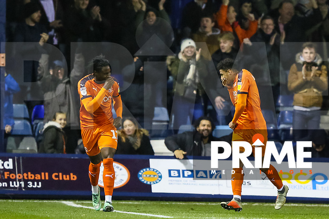 Goal scorer James Justin of Luton Town celebrates with Pelly-Ruddock Mpanzu of Luton Town during the Sky Bet League 1 match between Luton Town and Bradford City at Kenilworth Road, Luton, England on 27 November 2018. Photo by Thomas Gadd.