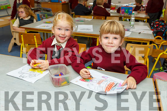 Grace Conway and Caoimhe Griffin enjoying their first day in Junior infants in Scoil Maomh Eirc Kilmoyley on Monday.