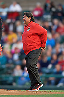 Rochester Red Wings athletic trainer Larry Bennese walks to the mound after Stephen Gonsalves (not shown) was hit by a broken bat during a game against the Buffalo Bisons on August 25, 2017 at Frontier Field in Rochester, New York.  Buffalo defeated Rochester 2-1 in eleven innings.  (Mike Janes/Four Seam Images)