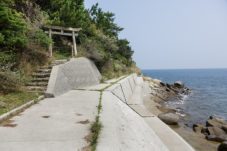 Aoshima, Ehime prefecture, September 4 2015 - Small shinto shrine on the eastern part of Aoshima island.<br /> Aoshima (Ao island) is one of the several &laquo; cat islands &raquo; in Japan. Due to the decreasing of its poluation, the island now host about 6 times more cats than residents.