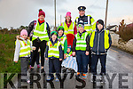 "Scoil Naomh Eirc Kilmoyley National School is encouraging parents and pupils to ""Park and Stride"" as part of an Taisce's ""Big Travel Challenge. On Tuesday they had an escort by the Gardaí. Pictured Front l-r  Molly Nolan Jevon Carey, Eoin Corridan Jack Corridan  Ciaran Sheehy, Darragh Corridan Back l-r Diane Jeffers Fidel Corridan and Garda Steven Griffin"