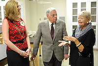 NWA Democrat-Gazette/ANDY SHUPE<br /> Corrine Wulkan Larson (right) speaks Tuesday, June 9, 2015, with Angel Holland (left), director of clinical education for Department of Physical Therapy at the University of Arkansas for Medical Sciences, and Lewis Epley Jr. of Fayetteville Tuesday, June 9, 2015, during a tour of the new physical therapy school on the UAMS Northwest Campus in Fayetteville.