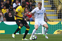 Abdoulaye Doucoure of Watford is closely marked by Jay Fulton of Swansea City during the Premier League match between Watford and Swansea City at Vicarage Road Stadium, Watford, England, UK. Saturday 15 April 2017