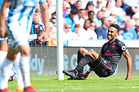 A happy Pierre-Emerick Aubameyang of Arsenal as he slots home to make it 1-0 during the Premier League match between Huddersfield Town and Arsenal at the John Smith's Stadium, Huddersfield, England on 13 May 2018. Photo by Thomas Gadd / PRiME Media Images.