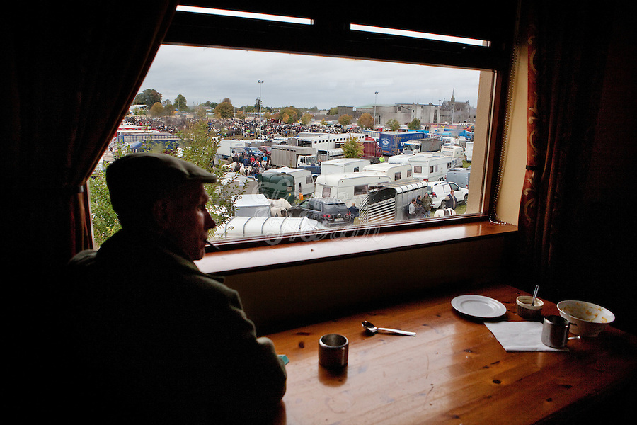 4/10/2010.  A horse trader sits in a bar overlooking the Fair Green at the Ballinasloe Horse Fair, Ballinasloe, Ireland. Picture James Horan