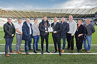 Matchball sponsors with Lee Trundle during the Sky Bet Championship match between Swansea City and Wigan Athletic at the Liberty Stadium, Swansea, Wales, UK. Saturday 19 January 2020