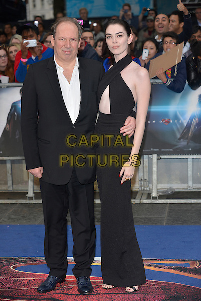 Hans Zimmer &amp; guest<br /> 'Man Of Steel' UK film premiere, Empire cinema, Leicester Square, London, England. <br /> 12th June 2013<br /> full length black suit dress criss cross halterneck  <br /> CAP/PL<br /> &copy;Phil Loftus/Capital Pictures