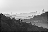 There is a scenic viewpoint along 360 west of Austin. On this morning, I was returning from shooting at Pennybacker Bridge when I noticed the fog and outline of the Austin skyline I turned around and captured a few images of the layered hills and downtown Austin. This image is the black & white version