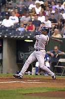 Twins left fielder Jacque Jones hits a double in the second inning against the Royals at Kauffman Stadium in Kansas City, Missouri on August 25, 2001.  Minnesota won 7-1.