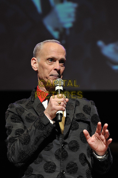 John Waters performing his one man show, 'A John Waters Christmas', Royal Festival Hall, London, England. .5th December 2011.stage concert live gig performance black polka dot jacket microphone half length hand.CAP/MAR.© Martin Harris/Capital Pictures.