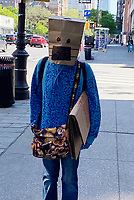 NEW YORK, NY - MAY 21: Woman spotted wearing a paper bag with a drawn-on mask while walking in Greenwich Village during the coronavirus pandemic in New York City on May 21, 2020. <br /> CAP/MPI/RMP<br /> ©RMP/MPI/Capital Pictures