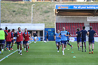 The Wycombe Wanderers players warm up ahead of The Checkatrade Trophy match between Northampton Town and Wycombe Wanderers at Sixfields Stadium, Northampton, England on 30 August 2016. Photo by David Horn / PRiME Media Images.