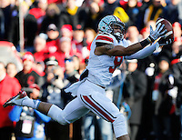 Ohio State Buckeyes wide receiver Devin Smith (9) catches a touchdown pass in the first quarter of the college football game between the Ohio State Buckeyes and the Michigan Wolverines at Michigan Stadium in Ann Arbor, MI Saturday afternoon, November 30, 2013. As of half time the Ohio State Buckeyes were tied with the Michigan Wolverines 21 - 21. (The Columbus Dispatch / Eamon Queeney)