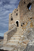 "Staircase leading to the main entrance of the castle, Queribus Castle or Chateau de Queribus, Cathar Castle, Cucugnan, Corbieres, Aude, France. This castle, built from 13th to 16th centuries, is considered the last Cathar stronghold. It sits on a high peak at 728m. It is one of the ""Five Sons of Carcassonne"" or ""Cinq Fils de Carcassonne"". It is a listed monument historique and has been fully restored, restoration work being completed in 2002. Picture by Manuel Cohen"
