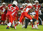 Lawndale, CA 09/26/14 - Chris Murray (Lawndale #12) and Matthew Ho (Peninsula #52) in action during the Palos Verdes Peninsula vs Lawndale CIF Varsity football game at Lawndale High School.  Lawndale defeated Peninsula 42-21